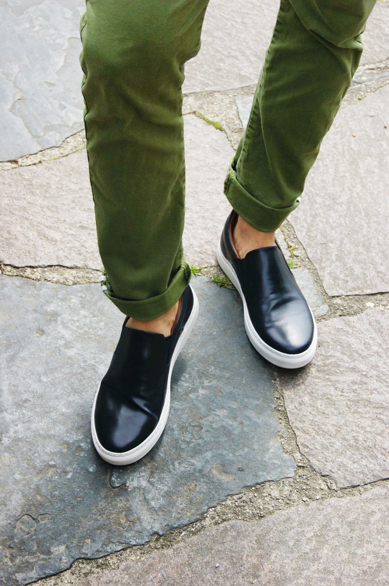 ivo saraf is showing his shoes and green pants